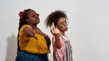 Afro Women Showing Middle Fingers And Looking Satisfied With Themselves