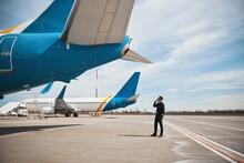 Pilot Checking Rear Part Of Plane Before Flight