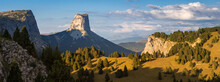 Mont Aiguille And The Vercors High Plateaus In Autumn At Sunset (panoramic). Vercors Regional Natural Park In Isere (Rhone-Alpes), French Alps, France