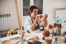 Joyful Pottery Designer Preparing Blade Of Her Carver