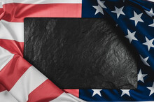 Black Stone Plaque On The American Flag With Place For Text.