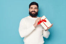 Bearded Man With A Gift In His Hands White Sweater Gift As A Holiday