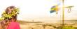 Leinwandbild Motiv Frau mit Blumenkranz bei Mittsommer in Schweden