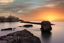 Clouds At Sunrise Over The Calm Sea Surrounding Vieste, Foggia Province, Gargano National Park, Apulia, Italy