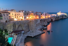 Illuminated Pool Of Luxury Resort By The Sea At Dusk In Vieste Old Town, Foggia Province, Gargano, Apulia, Italy