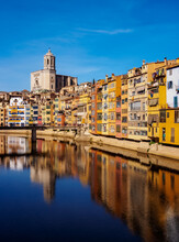 Colourful Houses And The Cathedral Reflecting In The Onyar River, Girona (Gerona), Catalonia