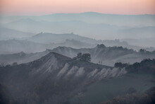 Dusk Over Hills Where Many Layers Are Covered By Fog, Emilia Romagna, Italy