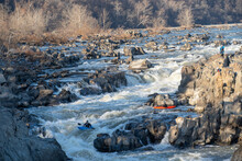 Kayakers Thread Their Way Down A Series Of Challenging Drops That Make Up Great Falls Of The Potomac River, Virginia