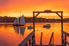 A Schooner Returns To Dock At Sunset At Bailey Island, Casco Bay, Maine