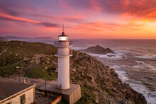 Aerial Sea Landscape View Of Cape Tourinan Lighthouse At Sunset With Pink Clouds, Galicia