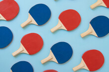 Red And Blue Ping Pong Paddles On Blue Background