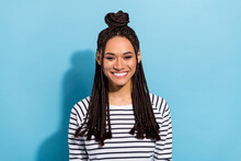 Photo Portrait Of Smiling Girl With Dreadlocks Top-knot Wearing Striped Shirt Isolated Pastel Blue Color Background