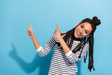 Photo portrait of girl with dreadlocks smiling showing copyspace recommending isolated pastel blue color background