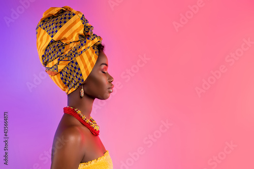 Profile side photo of stunning afro american lady look empty space wear traditional outfit isolated on glow background