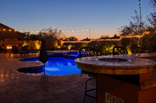 A High Definition View Of A Desert Landscaped Backyard In Mesa Arizona, With A Pool Spa, Outdoor Fireplace And Kitchen.