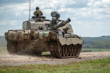 Action Shot Of A British Army Challenger 2 FV4034 Main Battle Tank On A Military Exercise, Salisbury Plain, UK