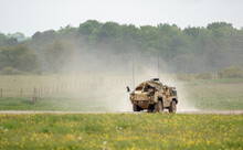 British Army Supacat Jackal MWMIK Rapid Assault, Fire Support And Reconnaissance Vehicle On Maneuvers In A Demonstration Of Firepower, Salisbury Plain Military Training Area UK