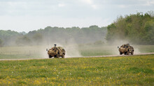 2 British Army Supacat Jackal MWMIK Rapid Assault, Fire Support And Reconnaissance Vehicles On Maneuvers In A Demonstration Of Firepower, Salisbury Plain Military Training Area