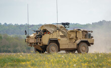 British Army Supacat Jackal MWMIK Rapid Assault, Fire Support And Reconnaissance Vehicle In Action On A Military Exercise, Salisbury Plain Military Training Area UK