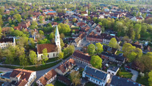 Aerial View Of Kuldiga Old Town With Red Roof Tilesand Evangelical Lutheran Church Of Saint Catherine In Kuldiga, Latvia.