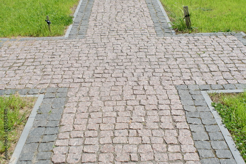 Canvas Print Granite pavement. Footpaths with granite cobblestones