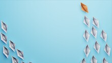 Stand Out Origami Paper Boats Following A Leader On A Light Blue Background With Space For Text