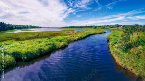 Foto River and marshland on Cape Breton Island near the Atlantic Ocean in rural Nova Scotia, Canada on a bright sunny summer's day