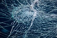 Broken Car Windshield Close-up, Round Dent, Many Cracks