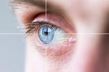 Closeup Eye Monitoring And Scanning. Biometric Scan Of Male Eye.