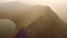 Dramatic Aerial Footage Showing Impressive Mountain Ridge Striding Edge On Helvellyn In The Lake District, UK.