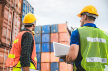 Logistic Worker Teamwork And Partner Of Foreman, Engineer, And Businessman Working In An International Shipping Area, Concept Of Business Industrial And Working In Container Yard To Import And Export