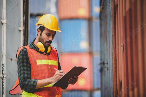 Fotografering engineer foreman working in container terminal in term of industry logistic carg
