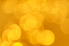 Abstract Photo Of Bokeh On The Surface Water Of Sea Or Ocean At Sunset Time With Golden Light Tone.