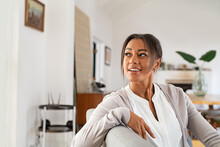 Pensive Mature Woman At Home