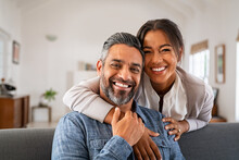 Mature Indian Couple Hugging And Looking At Camera