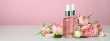 Skin Care Concept With Essential Rose Oil On Pink Background