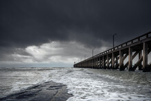 Pier In The Sea With Thunder Clouds