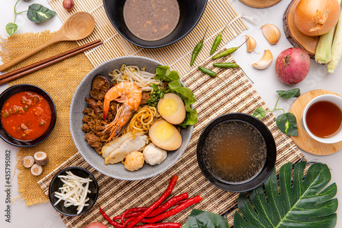 Canvastavla Hokkien mee are tossed in pork lard and served with fish balls, shrimp