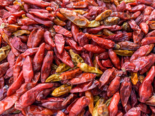 Dried Red Chili Peppers In Group With Close Up View.