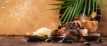 Various Cocoa Products Set: Beans, Powder, Butter, Dark Chocolate, Grated Cocoa On Wooden Table Background
