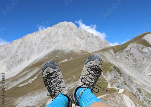 Obraz na plátně trekking shoes during the rest of the walker in the mountains and the Gran Sasso