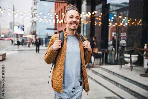 Mirthful person feeling good while walking alone Fototapet