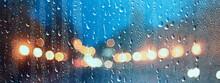 Wet Window City Lights Rain Drops, Abstract Background Autumn Winter Glow Glass