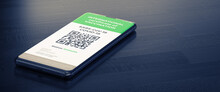 COVID-19: Digital Green Certificates On Smart Phone Screen. A Smart Phone Lying On A Dark Surface With A Vaccinated Digital Health Passport.