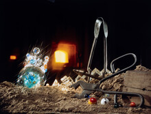 At The Studio Of A Glassblower. Oven And Glassblower Tools.  Glass. Sand.