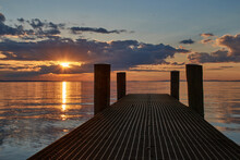 Pier At Sunset On The Lake