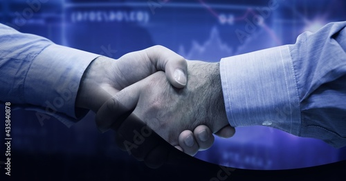 Mid section of two businessmen shaking hands against financial data processing on blue background