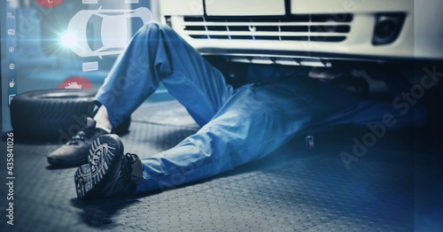 Composition of interactive screen with digital car drawing over car mechanic lying under car