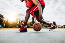 Basketball Street Player Dribbling With Ball On The Court - Streetball, Training And Activity Concept