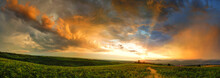 Majestic Sunset With Storm Clouds. Panorama In Countryside